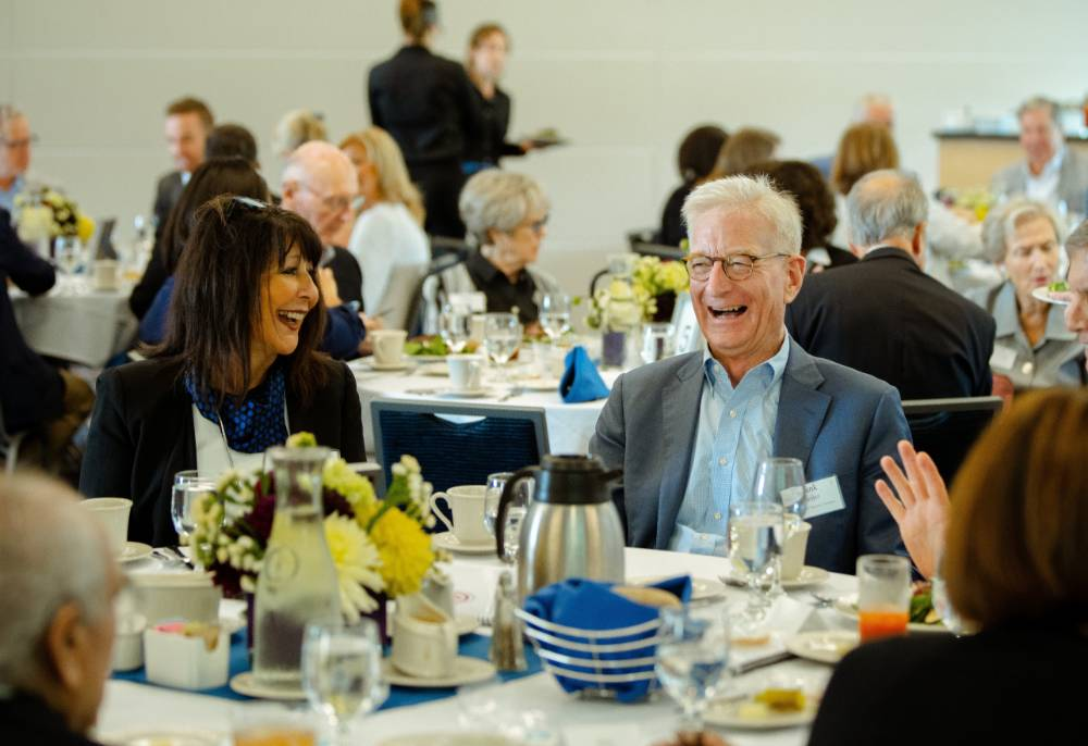 President Philomena V. Mantella sitting and laughing with guests at the Foundation Annual Meeting